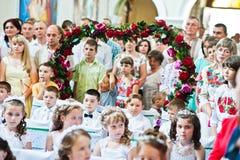 Mukyluntsi, Ukraina - 26 Czerwiec, 2016: Pierwszy święty communion Zdjęcie Stock