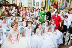 Mukyluntsi, Ukraina - 26 Czerwiec, 2016: Pierwszy święty communion Fotografia Stock