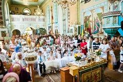 Mukyluntsi, Ukraina - 26 Czerwiec, 2016: Pierwszy święty communion Zdjęcia Stock
