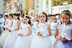 Mukyluntsi , Ukraine - 26 june, 2016: First holy communion. Royalty Free Stock Image