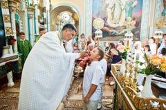 Mukyluntsi , Ukraine - 26 june, 2016: First holy communion. Royalty Free Stock Image