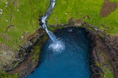 Mulafossur waterfall aerial drone view in Gasadalur, Vagar