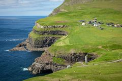 Mulafossur waterfall in Gasadalur village in Faroe Islands, North Atlantic Ocean. Nordic Natural Landscape