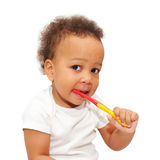 Mulatto black baby brushing teeth. Stock Photo