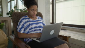 Mulatto businesswoman typing on pc stock footage