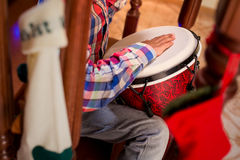 Mulatto child playing percussion drum. stock photos