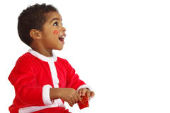 Mulatto child on a White background. Dressed as Santa Claus Stock Photo
