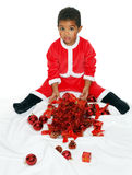 Mulatto child on a White background. Dressed as Santa Claus Royalty Free Stock Images
