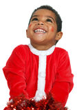 Mulatto child on a White background. Dressed as Santa Claus Stock Photos
