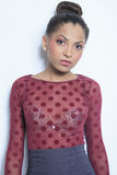 Mulatto fashion model wearing in dot over a gray Stock Photo