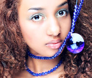 Mulatto, female, women, beautiful, afro, elegance,. Young mulatto woman with a fashionable Afro hairstyle showing a beautiful necklace Stock Photo