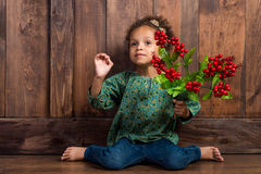 Mulatto girl with berries in her hands Royalty Free Stock Photography