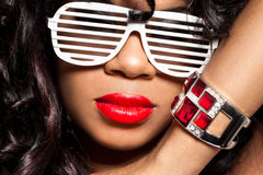 Mulatto girl with a bracelet. Mulatto girl with a ruby bracelet Royalty Free Stock Photos