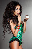Mulatto girl with cake Stock Photos