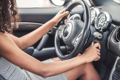 Mulatto girl in car Stock Photography