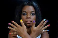 Mulatto girl with colorful fingernails Stock Photos