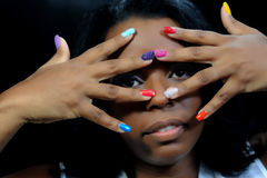 Mulatto girl with colorful fingernails Royalty Free Stock Images