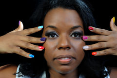 Mulatto girl with colorful fingernails Stock Photography