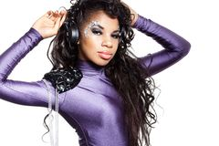 Mulatto girl DJ listens music Royalty Free Stock Photography