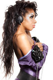 Mulatto girl DJ listens music Stock Image