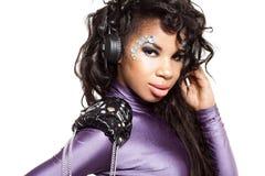 Mulatto girl DJ listens music Stock Photos