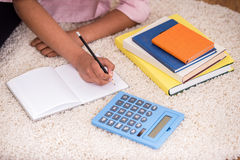 Mulatto girl doing homework Stock Images