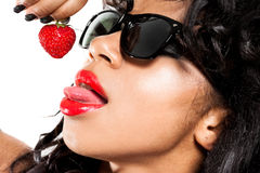 Mulatto girl with strawberry Stock Image