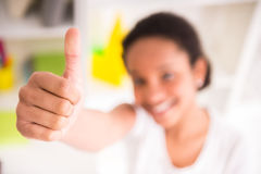 Mulatto girl with thumb up Stock Photo
