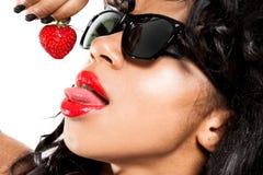 Mulatto Girl With Strawberry Stock Image