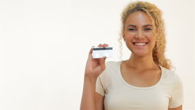 Mulatto girls showing thumbs-up with credit card stock footage