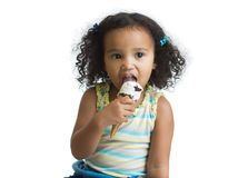 Mulatto kid eating ice cream isolated Royalty Free Stock Photography