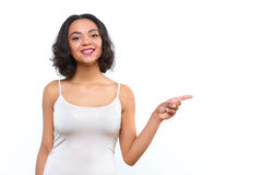 Mulatto lady pointing sideward with her finger Stock Images