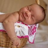Mulatto newborn baby sleeping in basket Royalty Free Stock Image