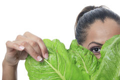 Mulatto person look through a salad Stock Photo