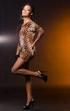 Mulatto woman on orange. Sexy fashionable mulatto woman on orange Royalty Free Stock Images