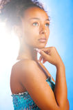 Mulatto woman on sky background Stock Image