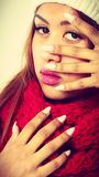 Mulatto woman in warm winter clothing showing nails Royalty Free Stock Photos