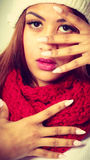 Mulatto woman in warm winter clothing showing nails Stock Photography