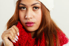 Mulatto woman wearing warm winter clothing, closeup Stock Photo