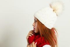 Mulatto woman wearing warm winter clothing. Winter clothing, fashion concept. Beautiful young mulatto woman wearing red woolen scarf white cap. Mixed race girl Stock Photos