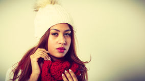 Mulatto woman wearing warm winter clothing Stock Images