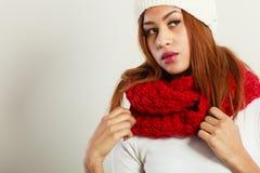 Mulatto woman wearing warm winter clothing Stock Image