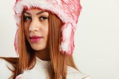Mulatto woman wearing winter fur cap Royalty Free Stock Photo