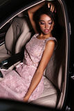 Mulatto woman wears luxurious dress,arrived on red carpet event Stock Photo
