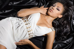 Mulatto woman in white dress. Fashionable mulatto woman in white dress Royalty Free Stock Images