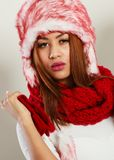 Mulatto woman in winter outfit. Clothing, fashion, people concept. Mulatto woman in winter outfit. Attractive lady has fur cap. Studio shot Stock Photos