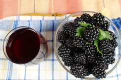 Mulberries and juice Stock Photos
