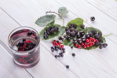 Mulberry berries, blackberries and currants detox water on wooden table royalty free stock photo