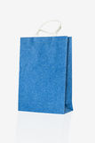 Mulberry blue paper bag on isolate white Royalty Free Stock Image