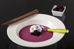 Mulberry cream soup on the plate Royalty Free Stock Image